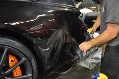 Professional application of computer cut Clear Bra / PPF / Paint Protection Film to desire areas