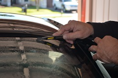 Professional edge cutting and shrinking preparation of the back window film